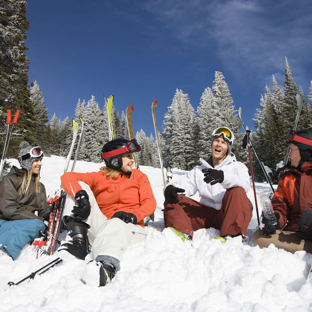 A family photo skiing in Colorado mountains
