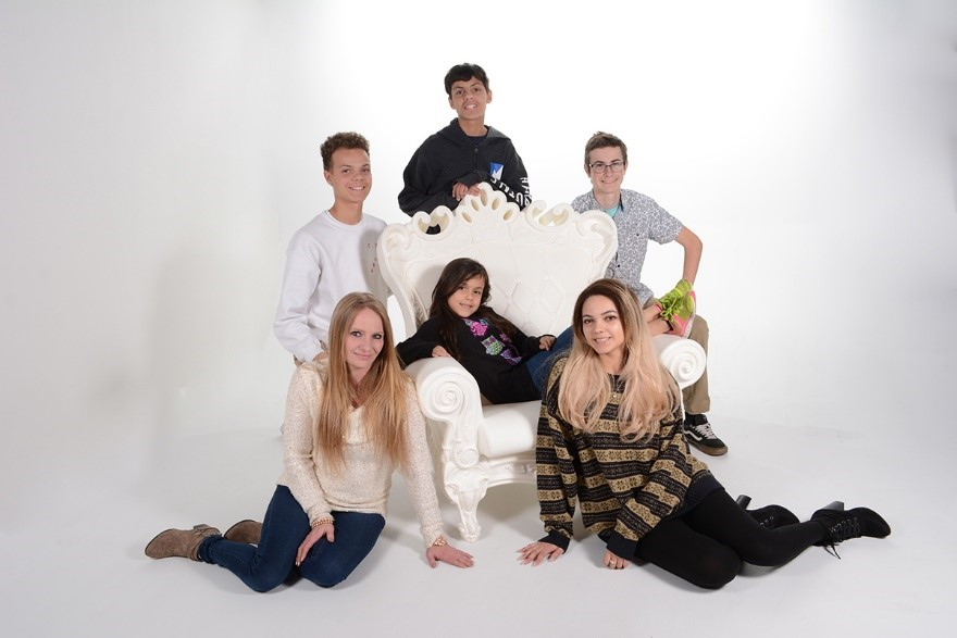 professional studio photograph of large family by andrae michaels portrait studio in colorado springs