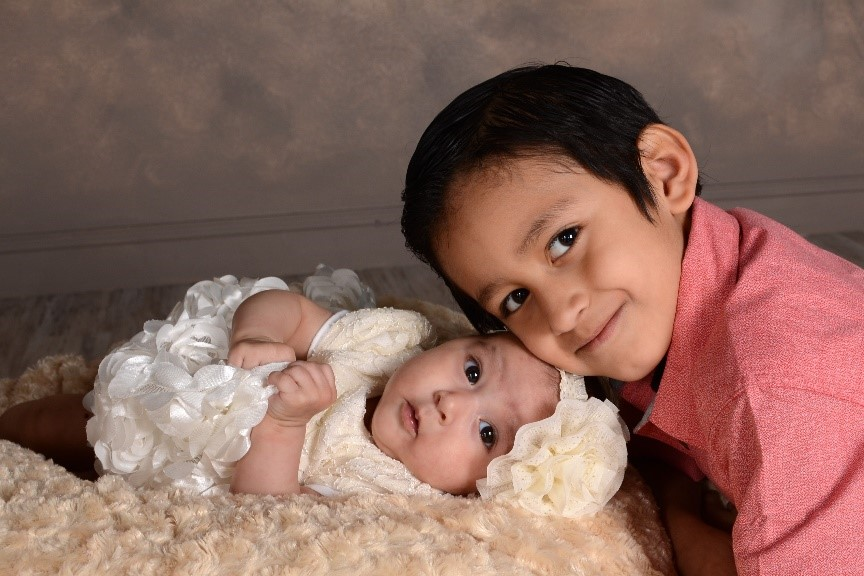 professional studio portrait of baby sister and little brother by andrae michaels portrait studios in colorado springs