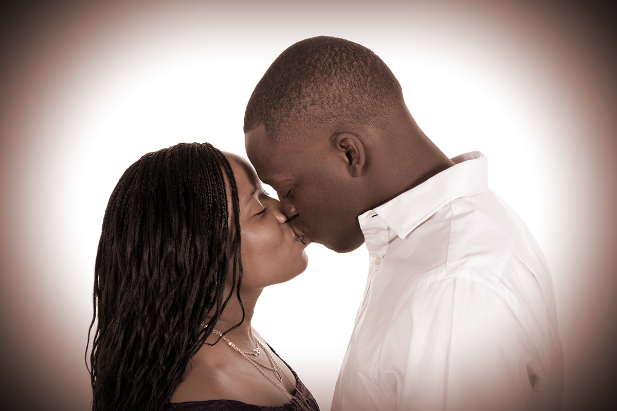 couple being photographed at andrae michaels photography studio in colorado springs