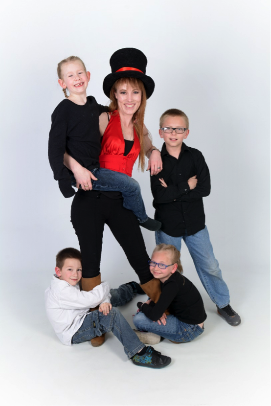 family poses for professional photograph taken by Andrae Michaels portrait studios